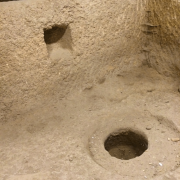 Remnants of an olive press carved into the bedrock of an ancient temple under the City of David .