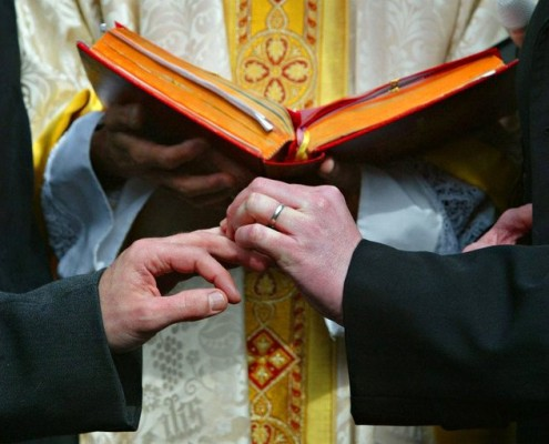 gay-wedding-with-priest-and-rings